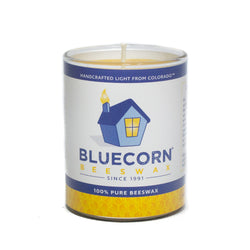 Raw, yellow beeswax candle in a clear 3oz glass. Bluecorn Beeswax label reads Handcrafted Light from Colorado since 1991. This votive candle measures 2.5 inches tall and 1.75 inches in diameter.