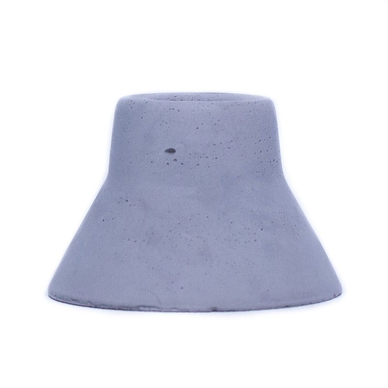 "Charcoal colored concrete taper candle holder. Candle holder measures 3"" at the base and narrows toward the top to fit a beeswax taper candle."