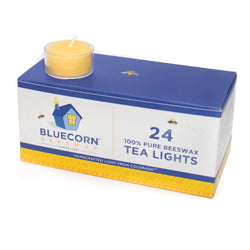 Bluecorn Beeswax 24-Pack 100% Pure Beeswax Tea Lights. Depicts raw beeswax tea light (golden color) in a clear, recyclable poly cup.