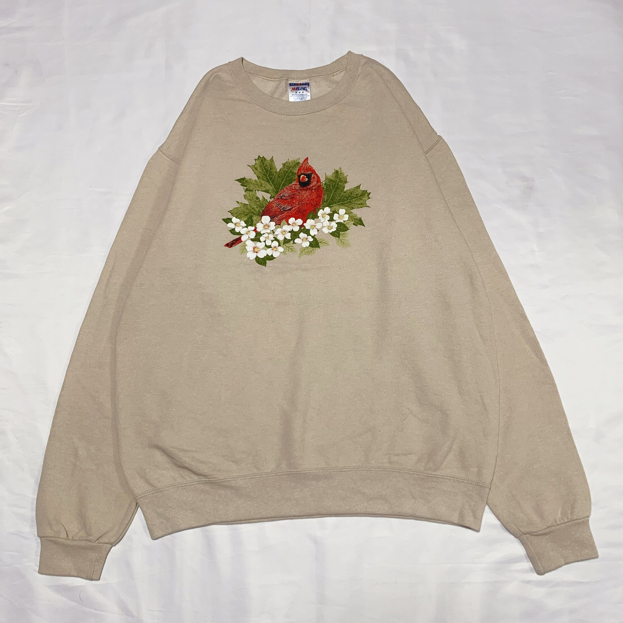 beige bird design sweatshirt