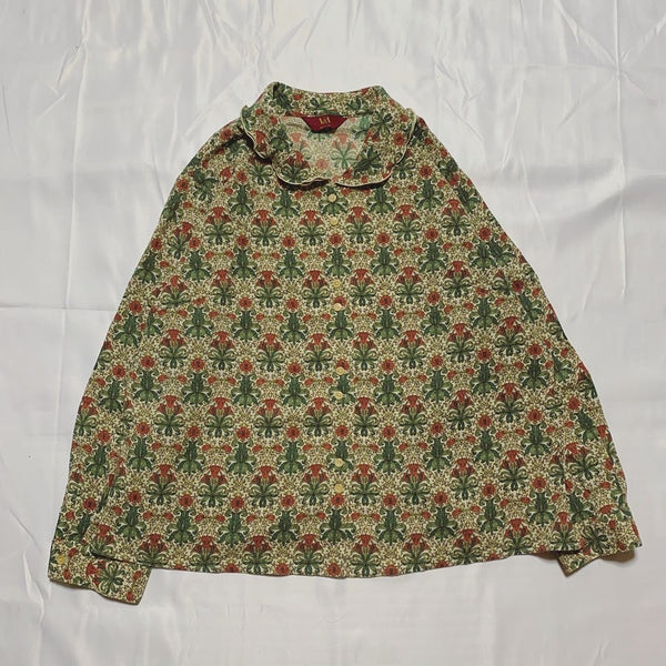 green flower design shirt