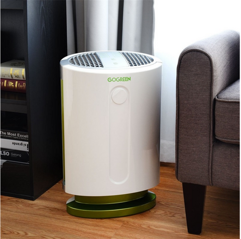 air purifier next to a couch