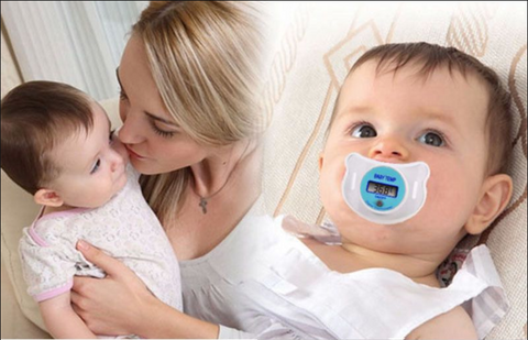 mother comforting infant with pacifier thermometer