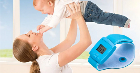 mom and baby with wrist thermometer