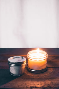Photo of candle flame with the word minimal over it
