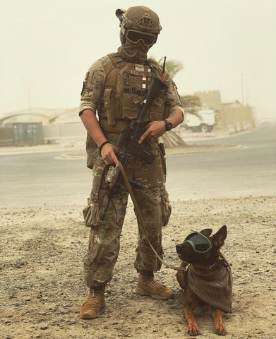 Military working dog team in dust storm