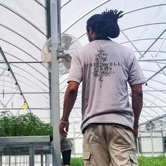 Oneal Latimore overseeing the care of hemp plants