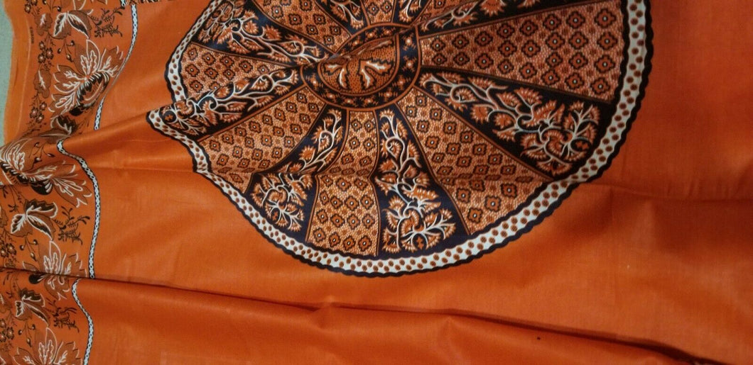 African Print With OrangeBackground And Bold Circular Motif Details 2yds