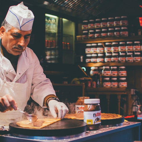 French creperie owner making a crepe