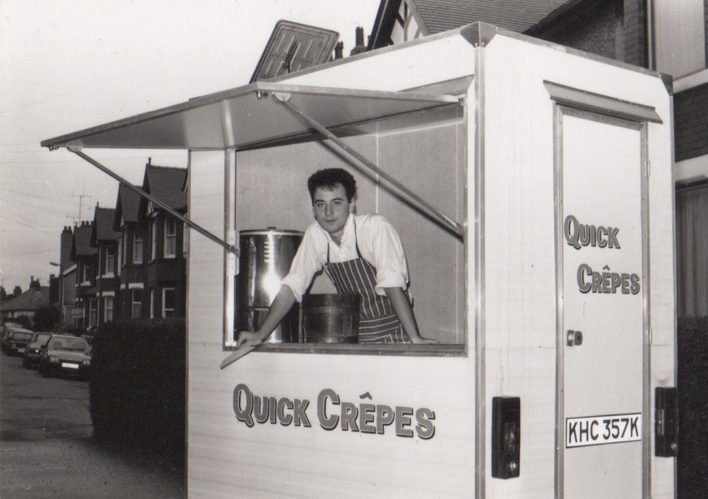 Hans Parker operating the first Quick Crêpes trailer, black and white