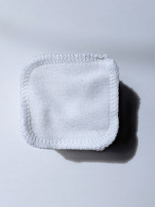 a stack of white cotton reusable facial rounds