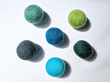Load image into Gallery viewer, 5 wool dryer balls that are cool toned varying from light blue an green, to dark blue and green