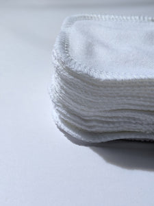 the side view of the stack of white cotton facial rounds