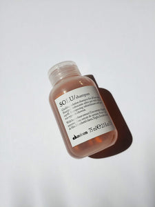 a small bottle of solu shampoo by Davines