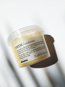 a small jar of the Dede conditioner by Davines - it is yellow in color