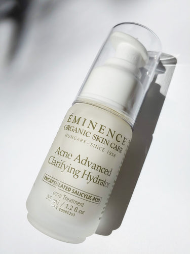 a bottle of acne advanced clarifying hydrator - an acne treatment by Eminence Organic Skin Care