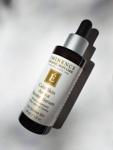 a bottle of the calm skin arnica booster-serum by Eminence. There is a dropper top to the bottle.