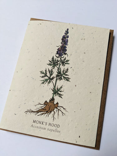 a plantable seed card - the card has a textured look from the seeds imbedded in the paper. There is a purple floral drawing on this one that says