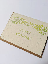 "Load image into Gallery viewer, a plantable seed card - the card has a textured look from the seeds imbedded in the paper. There is a leaf drawing on this one that says ""HAPPY BIRTHDAY"""