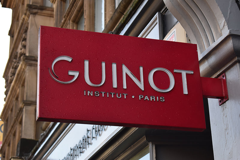 guniot sign outside the treatment rooms salon