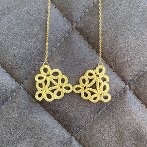 Cicee yellow tatted bow necklace