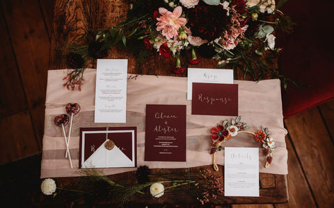 Modern yet classic wedding stationery in autumn colours of wine