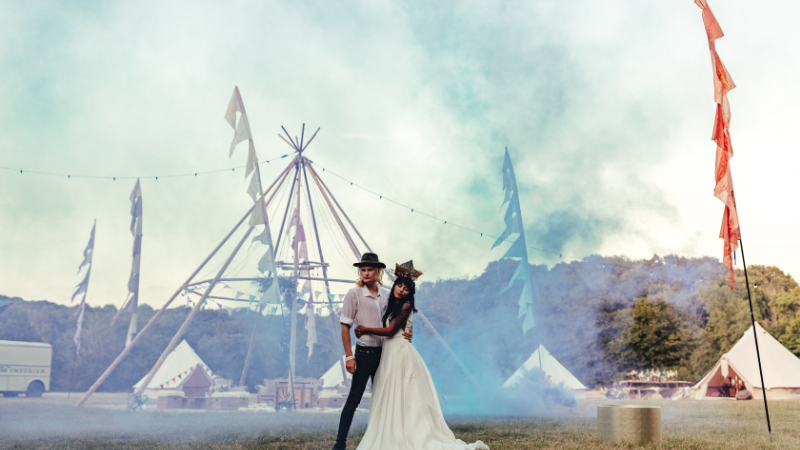 Tipi Wedding Inspiration - Styled Shoot Inspiration - Bride and Groom with Smoke Bombs Outside a Tipi