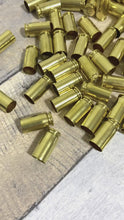 Load and play video in Gallery viewer, 40 Caliber Smith and Wesson Empty Brass Shells Cleaned Polished Used Casings Once Fired