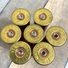 Load image into Gallery viewer, Used Red Shotgun Shells Headstamp Close Up  Winchester