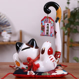 Tirelire chat Maneki-Neko japonais allongé en céramique