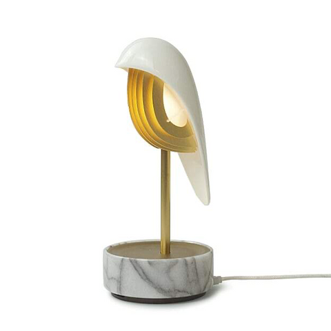 White marble and gold  unique alarm clock that uses nature sounds, bird calls, and soft ambient light to give users a refreshing and energizing start to their morning. It uses one-touch audio transmission to set the time and alarms without a network or Bluetooth needed.