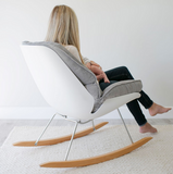 molded plastic eames inspired white rocking chair with cozy washable cushion