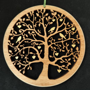 Wooden wall hanging of a tree with hearts and birds in the branches