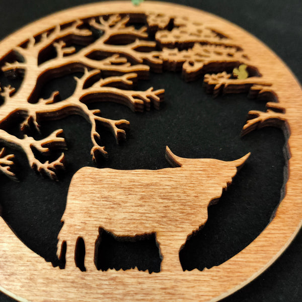 Wooden Hanging of Highland Cow under Trees