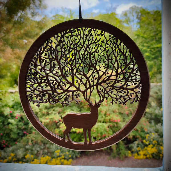 large wooden wall ornament of a stag with antlers that create branches of a tree