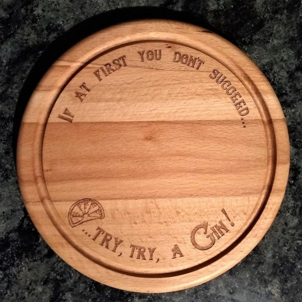 Beech wood chopping board engraved with the words if at first you don't succeed try, try a gin