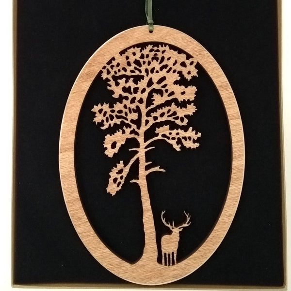Wooden Hanging of a Stag under Scots Pine Tree
