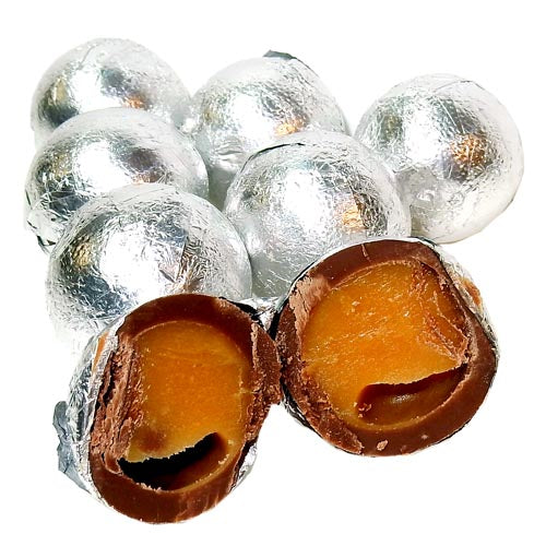 Silver colored foil wrapped caramel filled chocolate balls