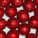 red foil covered chocolate balls