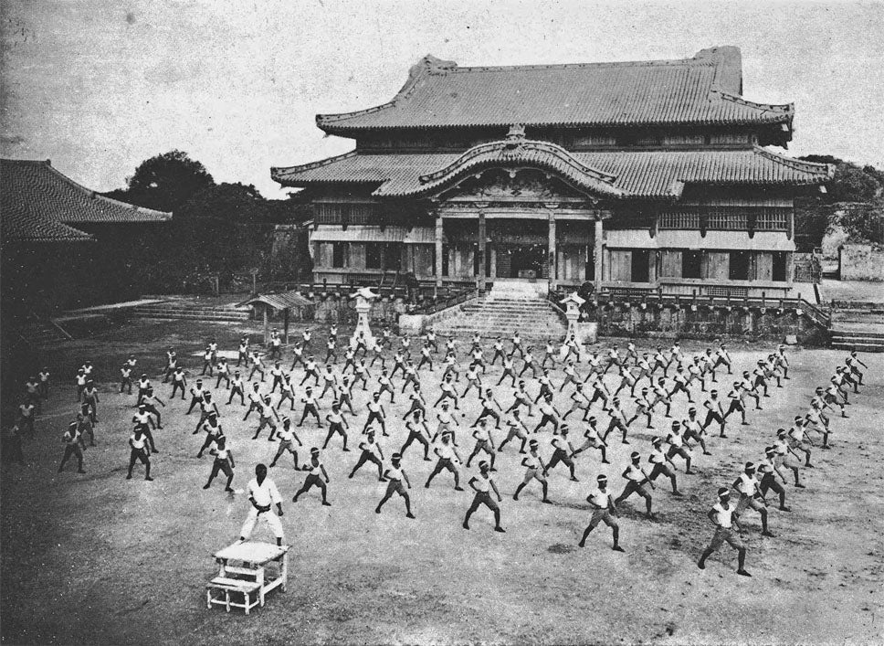 Photo 15 Courtesy: Wiki Commons, Karate training with Shinpan Gusukuma sensei at Shuri Castle, around 1938, Okinawa Prefecture, Japan.