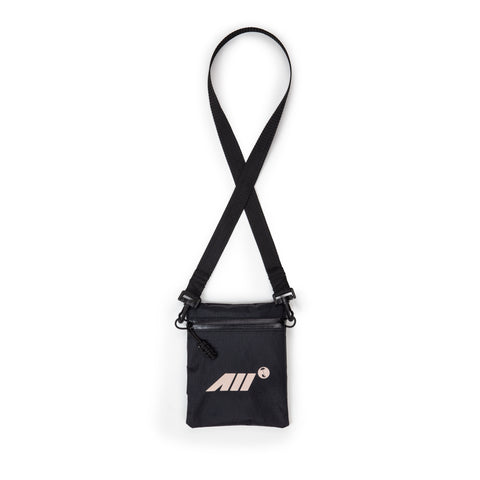 LOW PROFILE CROSS BODY BAG IN BLACK