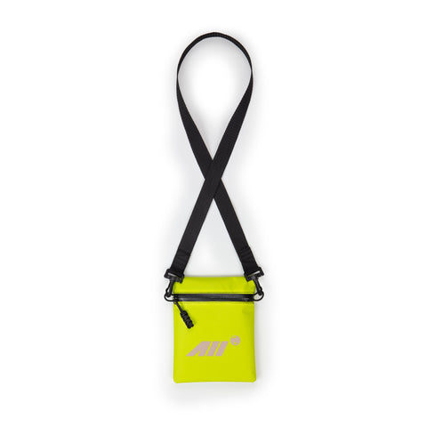 LOW PROFILE CROSS BODY BAG IN NEON