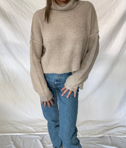 OPEN BACK TURTLENECK SWEATER