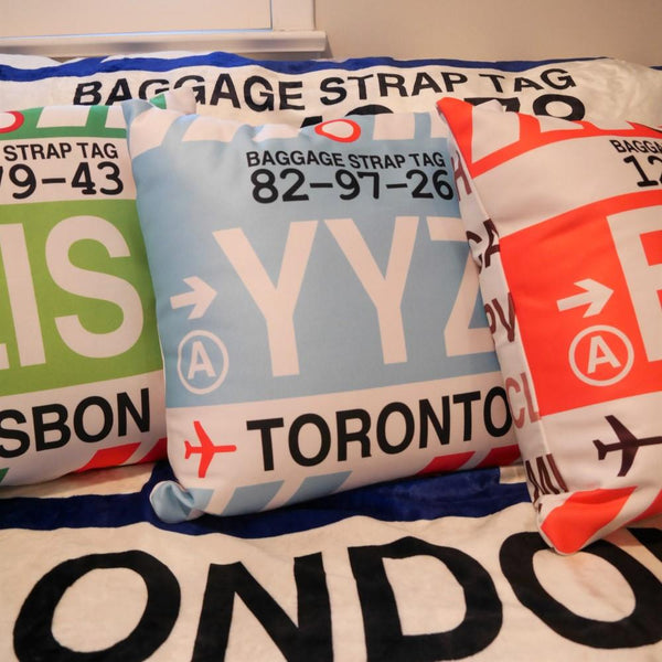 YHM Designs - YLL Lloydminster Throw Pillow - Airport Code and Vintage Baggage Tag Design - Image 1