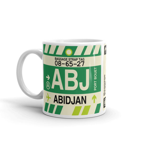 YHM Designs - ABJ Abidjan Airport Code Coffee Mug - Travel Theme Drinkware and Gift Ideas - Left