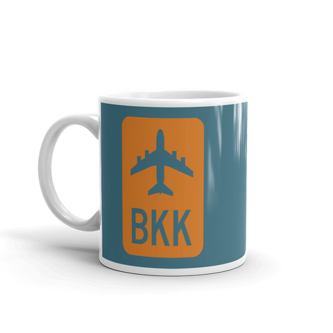 YHM Designs - BKK Bangkok Airport Code Jetliner Coffee Mug - Birthday Gift, Christmas Gift - Orange and Teal - Left