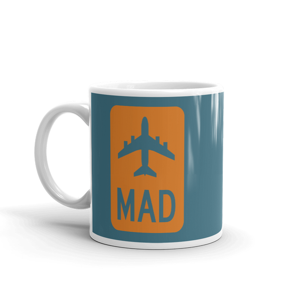 YHM Designs - MAD Madrid Airport Code Jetliner Coffee Mug - Birthday Gift, Christmas Gift - Orange and Teal - Left