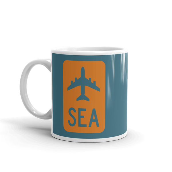 YHM Designs - SEA Seattle Airport Code Jetliner Coffee Mug - Birthday Gift, Christmas Gift - Orange and Teal - Left