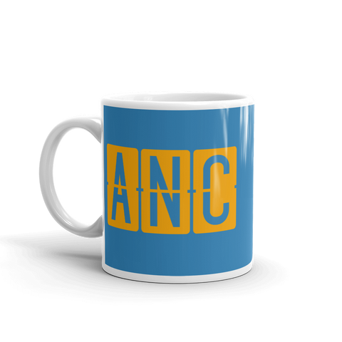 YHM Designs - ANC Anchorage Airport Code Split-Flap Display Coffee Mug - Birthday Gift, Christmas Gift - Orange and Blue - Left