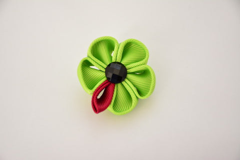 """The Gesture "" Green Floral Lapel"
